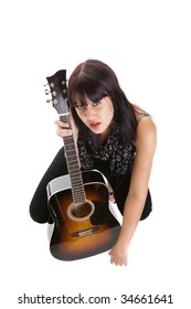 Wide angle view of a pretty musician with a guitar