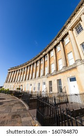 Wide angle view of the Royal Crescent in Bath, Somerset with a clear blue sky.