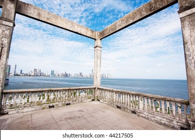 Wide angle view from the ruins of Club Clases y Tropas in Casco Viejo with the modern skyscrapers of Panama City in background. Panama, Central America.