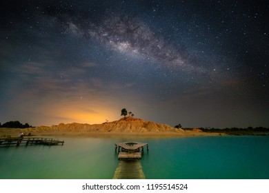 A wide angle view of the sand dune (Gurun Pasir Busung) in Bintan, Indonesia with Milkyway.