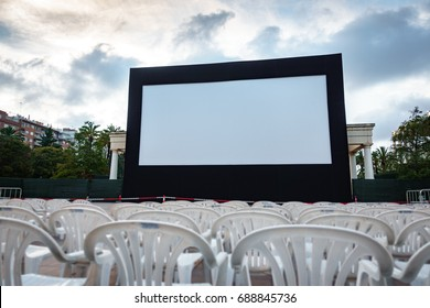Wide angle view of seats and screen at open-air cinema