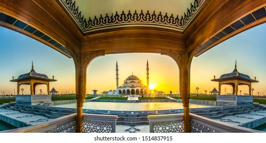 Wide angle view of Sharjah New Mosque famous Tourist Destination in Dubai Arabic Letter means: Indeed, prayer has been decreed upon the believers a decree of specified times