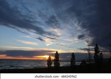 Wide angle view of South Haven, Mi, sunset with lighthouse.