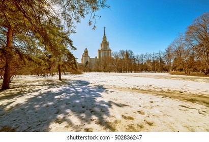 Wide angle view of spring park in the campus of Moscow university with long shadows