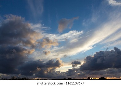 Wide angle view of a summer evening sky with light and dark clouds