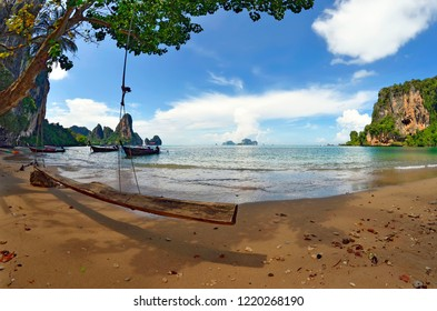 Wide angle view of the Tonsai bay between Ao Nang and Railay with a rope swing in the foreground