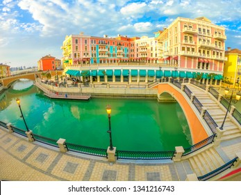 Wide angle view of two bridge in Venice at Qanat Quartier in the Pearl-Qatar, Persian Gulf, Middle East. Aerial view picturesque and luxurious district of Doha, Qatar, in venetian style.