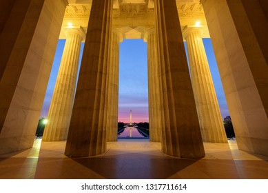 Wide angle view of Washington Monument with its reflection  from Lincoln Memorial at Sunrise, Washington DC