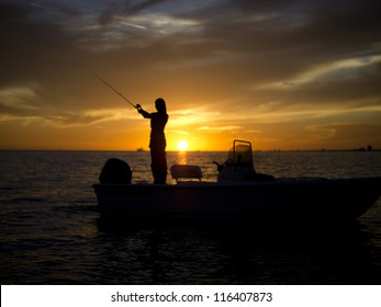 Wide angle Woman fishing Mississippi Gulfport Biloxi Sunset