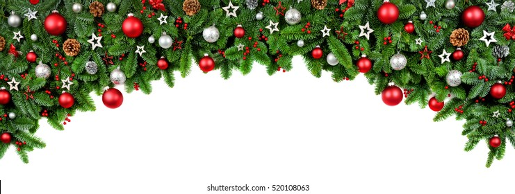 wide arch shaped christmas border isolated on white composed of fresh fir branches and ornaments