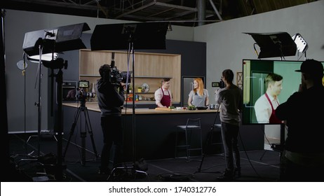 WIDE Behind the scenes of studio set, shooting TV television cooking show featuring celebrity chef, professional TV production