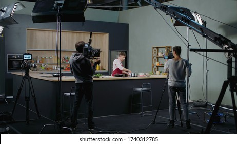 WIDE Behind the scenes of studio set, shooting TV television cooking show featuring celebrity chef, professional TV production - Shutterstock ID 1740312785