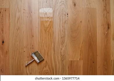 wide brush on wooden floor top view