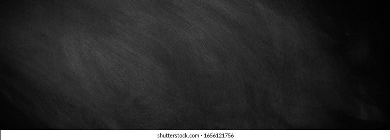 wide Chalkboard texture background. blackboard wall backdrop wallpaper, dark tone. black banner billboard.