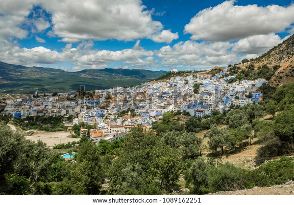 Wide city view of the Blue city Chefchaouen from the top of the mountain. Morocco, Africa