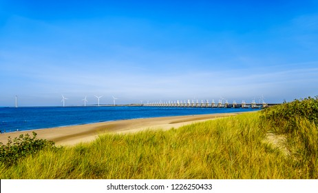 The wide and clean sandy beach at Banjaardstrand along the Oosterschelde inlet at the Schouwen-Duiveland peninsula in Zeeand Province in the Netherlands. The Storm Surge Barrier in the background