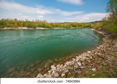 Wide clear river flowing in the countryside