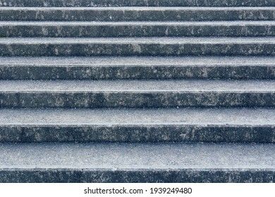 Wide concrete steps. These are dirty from years of exposure to rain and wind.