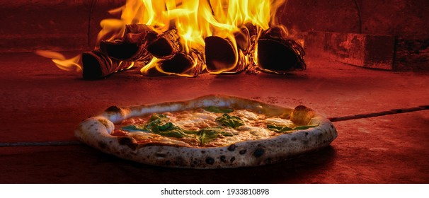wide cover photo image of traditional wood fired oven pizza fresh baked brick inside pizzeria