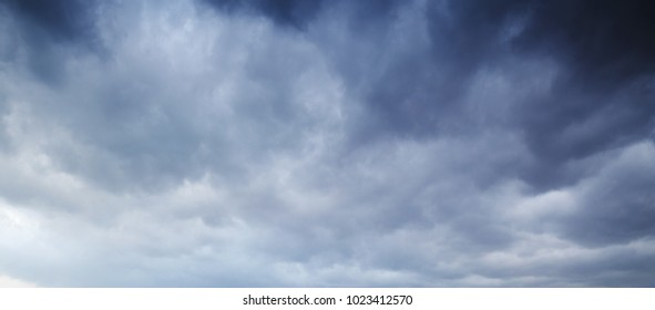 Wide dark dramatic sky with stormy clouds, abstract natural background photo