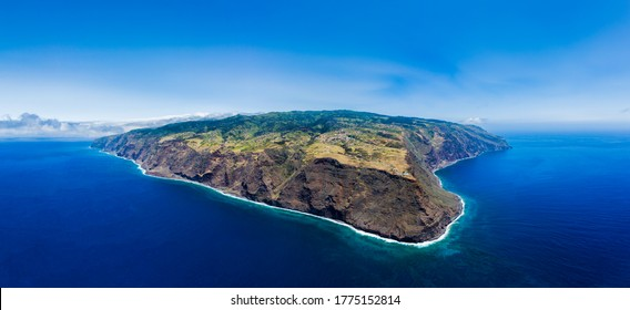 """Wide drone aerial panoramic view of Madeira island from """"Ponta do Pargo"""" lighthouse."""