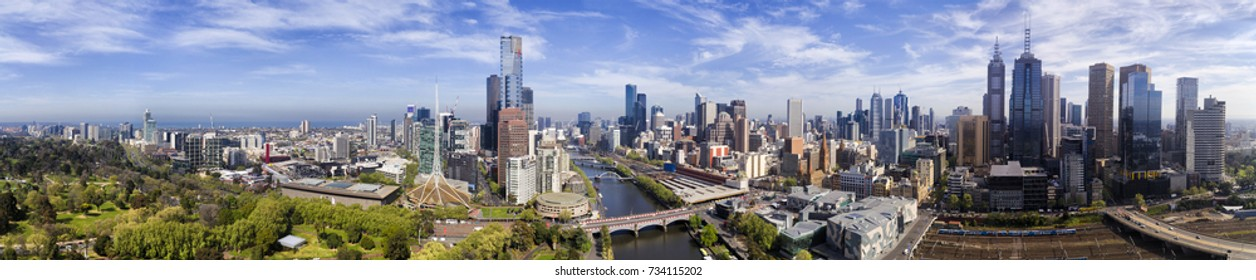 Wide elevated panorama of Melbourne city CBD from South Yarra to Yarra river, flinders station and train station on a sunny summer day.