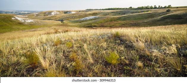 Wide evening view of steppe on chalk hills of Rovensky nature park in Belgorod region, southern Russia