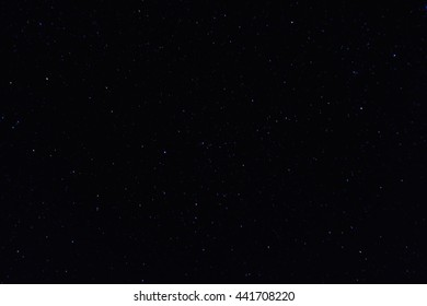 A wide field astrophotographic image showing real stars.