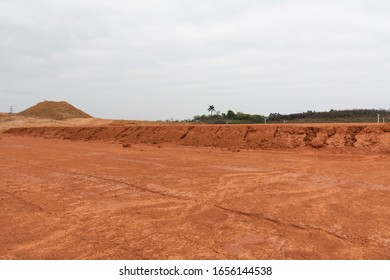 Wide and flat red dirt construction site