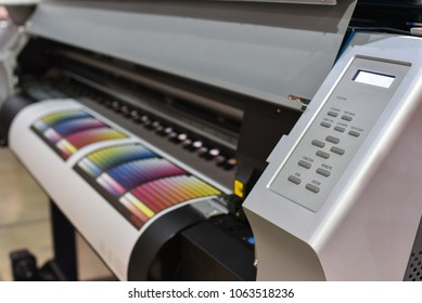 Wide format printer in work. Printing test image