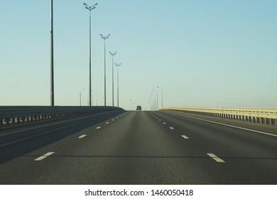 Wide highway. long roadway background. road going into the distance