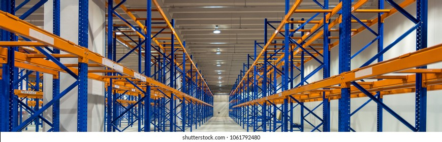 Wide image of empty shelves in distribution warehouse