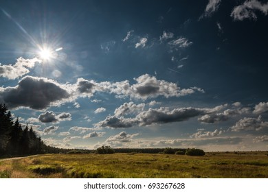 Wide landscape with sun