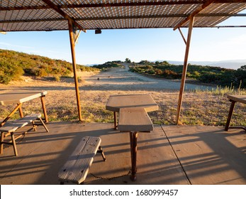 Wide open outdoor shooting range stall in a rural area in the early morning.