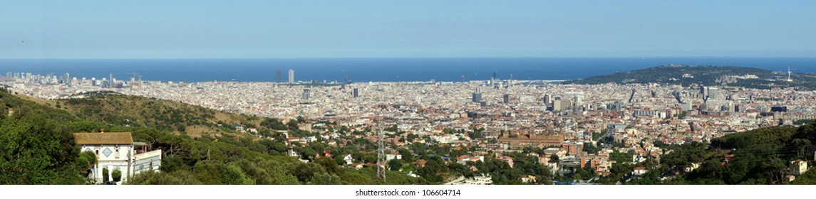 Wide panorama of Barcelona city at the Mediterranean Sea.