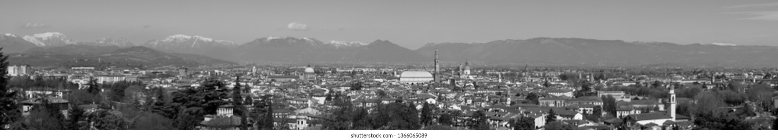 wide panorama of the city of Vicenza and the famous monument called Basilica Palladiana with the tall Clock Tower. Vicenza, Veneto, Italy - April 2019