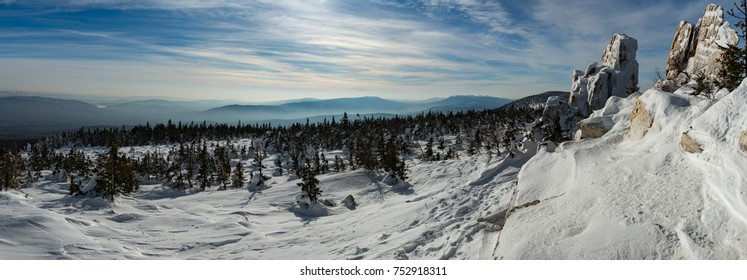 Wide panorama of snow covered mountain on Taganay, Ural, Russia