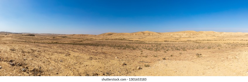 Wide panorama of stone desert at winter