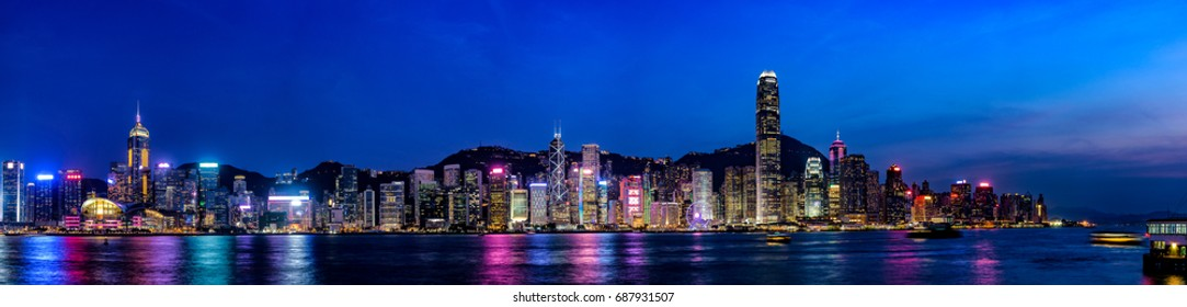 Wide panorama of Victoria Harbor night view at Hong Kong, China