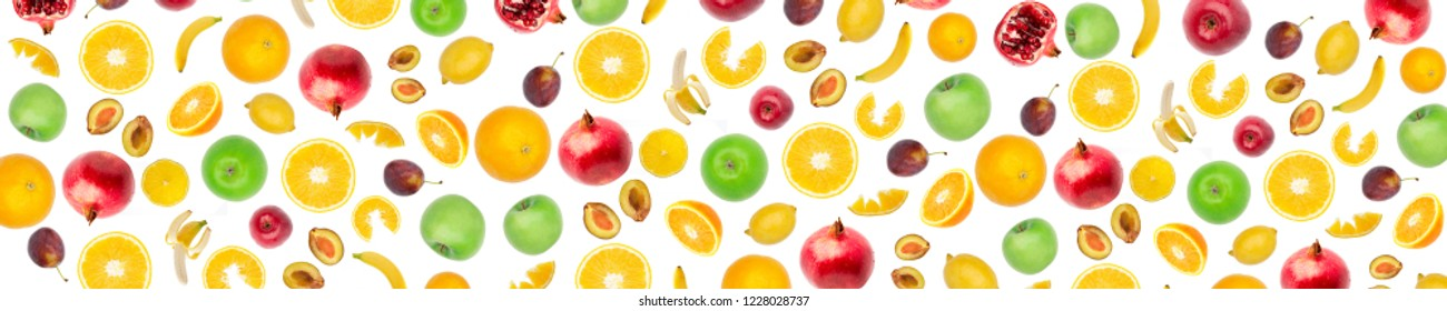 Wide panoramic collage fresh fruit isolated on white background. Bananas, citrus fruits, apples, plums, pomegranate, lemons. Skinali food