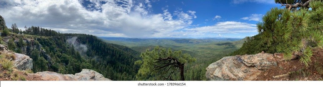 Wide panoramic image from the top of the Mogollon Rim, in July of 2020, during the Northern Arizona Monsoon season.