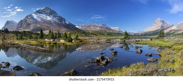 Wide Panoramic Landscape Scenic View of Baker Lake and Distant Canadian Rocky Mountain Peaks near Lake Louise in Banff National Park