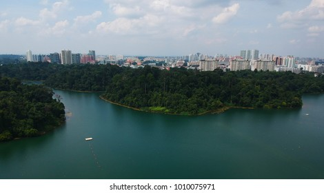 Wide panoramic photo taken with drone of the most important freshwater natural reserve in Singapore, the reservoir Mc Ritchie