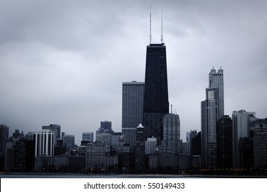 Wide panoramic view of Chicago skyline on a cloudy day, as seen from the Lakefront Trail.