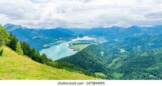 Wide panoramic view of Lake Wolfgangsee, mountains and hills from Zwolferhorn mountain above Sankt Gilgen in the Salzkammergut region, Austria