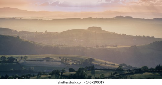 Wide panoramic view over scenic countryside hills in Shropshire, United Kingdom