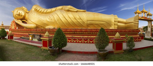 Wide Panoramic View of Reclining Gold Covered Buddha Statue or the Great Stupa, a sacred Buddhist Monument in Pha That Luang, Vientiane, Laos Capital