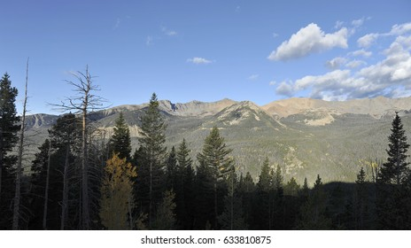 A wide panoramic view of the Rocky Mountains at dawn