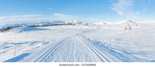 Wide panoramic view of snowy landscape with cross country ski track in Beitostolen. Winter in Norway
