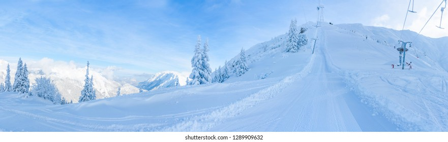 Wide panoramic view of winter landscape with snow covered trees and ski slopes in Seefeld in the Austrian state of Tyrol. Winter in Austria